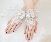 Wholesale Silk Lace Gloves - The new 2017 gloves free shipping Bow flower bud silk short trials with the bride wedding dress wedding accessories white