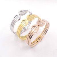 Wholesale Stainless Steel Taper Sets - Wholesale- Wholesale Fashion Designer Punk Arrow Bangle Retro Double Arrow Tapered Titanium Gold Plated   Silver Rivets Cuff Bangle