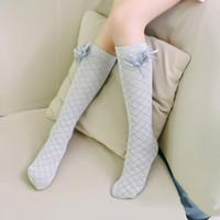 vestido legging niño al por mayor-Rodilla de los niños lindos calcetines altos para los niños muchachas de los cabritos Sólido Arco-nudo vestido de la princesa del algodón del calcetín de la pierna de ballet más caliente nueva marca