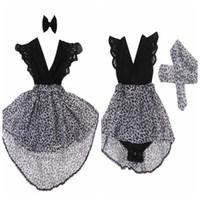 ingrosso vestiti di stampa nero del leopardo-Vestito da manicotto del merletto di arco dei capelli dei vestiti del bambino dei vestiti della stampa del leopardo delle ragazze di estate piccole sorelle che abbinano i vestiti infantili del pagliaccetto nero in azione