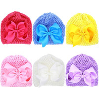 Wholesale grosgrain cotton - Fashion Baby Crochet Hollow Hats with Big Grosgrain Bows Baby Girl Summer Spring Knitting Elastic Caps Free Shipping BH28