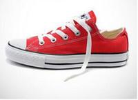 tops de encaje de mujer al por mayor-NUEVA size35-46 Nuevo Unisex Low-Top Mujeres Adultas Zapatos de lona de los hombres 13 colores deportivos estrellas tirada Atado Zapatos ocasionales de la zapatilla de deporte
