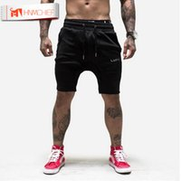 Großhandel-HNMCHIEF Männer Gymnastik Shorts mit Taschen Bodybuilding Kleidung Männer Golds Athlete Fitness Bermuda Weight Lifting Workout Baumwolle