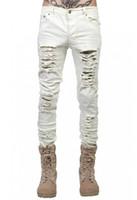 homens jeans brancos angustiados venda por atacado-Jeans masculinos da moda jeans rasgados para homens magros Angustiado designer fino motociclista hip hop ganhos preto / branco calças finas tamanho 28-38