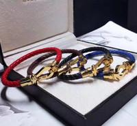 u браслет оптовых-TOP продавать роскошные ювелирные изделия популярны во франция оплетки неподдельной кожи U браслет для femele, мужчины способа оплетки реальных кожаных браслетов