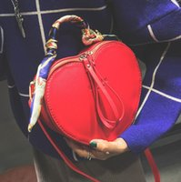 Wholesale Heart Shape Shoulder Bags - Heart shape designer shoulder bags for women autumn new tide ribbons women bags PU famous brand party evening women bags free shipping