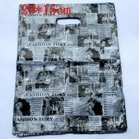 Wholesale Newspaper Gift Bags - Wholesale- 100pcs lot English Newspaper Design Plastic Gift Bag 20*15cm Clothes Jewelry Packaging Bag Big Plastic Shopping Bags 152021