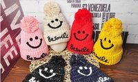 Wholesale Knitted Girls Cloche - 2017 new hat. Children's hat. Winter hat. Smiling face. Wool ball. Casual fashion hat. Boy. Girl. Baby. Knitted cotton. Keep warm. Add wool.