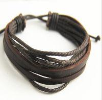 suministros de pulseras de cuero al por mayor-Retro pulsera de cuero tribal para hombres mujeres cuerda de cuero trenzado pulsera de cuero real negro y marrón Vintage joyería suministros