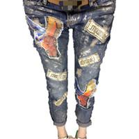 patchwork pantalones patrón mujeres al por mayor-Al por mayor-Denim Jeans Women Casual Fashion Patchwork Patrón rasgado Agujero Carta Pantalones Pantalones vaqueros de gran tamaño de las mujeres