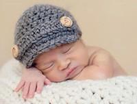 sombrero niña fotografía al por mayor-Sombrero de vendedor de periódicos Baby Kids Infant Toddler Girl Boy Recién nacido Otoño Invierno Niños Gorro de ganchillo de punto Skull Cap 100% Algodón Props Fotografía