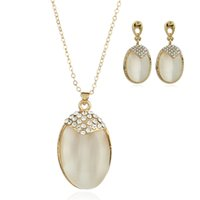 Wholesale China Lady Fashion Suit - High-grade oval-shaped cat eye gold-plated jewelry set 2 sets of earrings necklace suit fashion ladies wholesale JS240