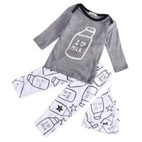 Wholesale Cute Casual Outfits For Girls - Wholesale- 2016 Fashion 3pcs Toddler Baby Kids Boy Girl Milk Bottle Printed Tops Pants Hat Cap Outfits Cute Clothing Sets for Children