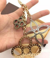 Wholesale Gold Ball Charms - Charm Key Holder flowers perforated Mahina leather Key Holder TAPAGE BAG CHARM M65090 Bag comes with Box dust bag