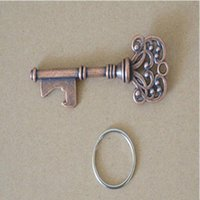 Wholesale beer uk - HouseHolds Novelty Mini UK Suck KeyChain Key Chain Beer Bottle Opener Stainless Bottle Opener Coca Can Opening Tool with Ring
