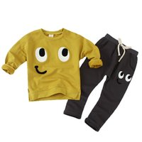 t-shirt jaune à manches longues achat en gros de-2017 New Arrival 3-8Y 2pcs / Sets Boy Clothes Outfit Long Sleeve Yellow Tshirt Pantalons noirs Cartoon Big Eyes Sportswear pour enfants
