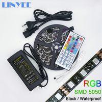 Wholesale 12v Power Pcb - Flexible SMD 5050 Black PCB RGB LED Strip IP65 Waterproof DC12V 60LED m 44KEY BOX MINI IR Remote Controller 12V 5A Power Adapter