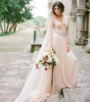 Wholesale Wedding Skirts Flowing - Blush Pink Bohemian Wedding Dresses with Lace Long Sleeves Deep V-neck Beaded Sash Flowing Soft Tulle Rustic Beach Bridal Gowns