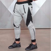 Men black jog pants - New Gold Medal Sports Fitness Pants Stretch Cotton Men s Fitness Jogging Pants Body Engineers Jogger Outdoor