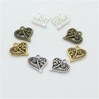 ingrosso fascini in lega di zinco-Fascino a forma di cuore con motivo floreale In lega di zinco Argento Oro Fascino galleggiante per medaglioni Ciondoli vintage Gioielli Orecchini fai-da-te con braccialetti adatti