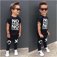 siyah gömlek erkek toptan satış-Moda çocuğun takım elbise Toddler Çocuk Baby Boy Kıyafetler siyah sıcak Giysiler Hiçbir ağrı yok kazanç mektuplar baskılı T-shirt Üst + XO Pantolon 2 adet serin çocuk ...