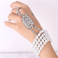 Wholesale Gate Bracelets - Fashion pearl crystal bracelet bride jewelry Europe and the United States hand back chain Gates than the same gift