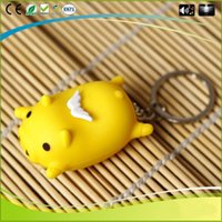 Cartoon Flying Pig Modelo de música Led Light Keyring Glow Key Chain Figura de ação para crianças Kid Toys Gift