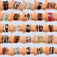 sonsuzluk deri kol düğmesi bilezikler toptan satış-El Yapımı 30 Mix Stil Infinity deri alaşım moda manşet Bilezik Charm Bilezik Vintage Aksesuarları Sevgilisi Hediyeler
