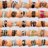 charme infinito misturado venda por atacado-Feitas à mão 30 Mix Estilo Infinito liga de couro moda manguito Pulseira Charm Bracelet Vintage Acessórios Amante Presentes