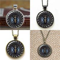 blaue ohrringe halskette großhandel-10pcs Triple Moon Göttin mit Blue Glow Anhänger Halskette Schlüsselanhänger Lesezeichen Manschettenknopf Ohrring Armband