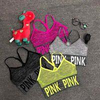 kırpma sutyen üstleri toptan satış-Seksi Kadınlar Yoga Yelek Shakeproof Koşu Spor Bras Yastıklı Mektup PEMBE Yoga Sutyen Dikişsiz Fitness Iç Çamaşırı Lady Kırpma Üstleri Tops
