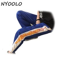 Wholesale Korea Hot Pants - Wholesale- NYOOLO Korea design hot sale novelty flame Print Harajuku loose casual Straight pants women and men elastic waist hip hop pants