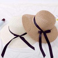 sombrero de paja para mujer de moda al por mayor-Diseñador moda señoras sombreros de cubo de paja con arco iglesia para mujer playa derby brimmed vestido gorras viseras casquillo del día de fiesta sombrero elegante