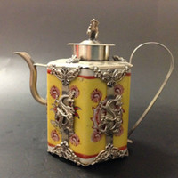 Wholesale Exquisite Chinese handwork inlaied with copper dragon yellow porcelain teapot with monkey lid