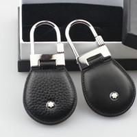 luxus-geschenk-boxen designs großhandel-Luxus Männer Schmuck Edelstahl echtes Leder Mode-Design Schlüsselbund Top Qualität Schlüsselanhänger für Männer Männer Geschenk mit Box