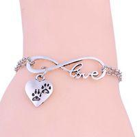 Wholesale dog chain bracelet resale online - Hot New European and American style Fashion women s Antique silver Alloy love Heart Dog Prints Infinity Pendant Bracelet Chain Charm