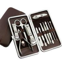 pinça de unha pinça pinças conjuntos de tesoura venda por atacado-12 PCS Manicure Set Prego de Aço Inoxidável Clipper Empurrador Arquivo Scissor Pinças Unhas Ferramentas Set Kit