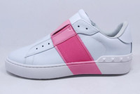Wholesale pink station - European station new rivets leather sports shoes color elastic edge low to help shoes men and women shoes