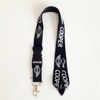 mp3 satılık ücretsiz gönderim toptan satış-Sıcak Satış! 20 adet Siyah MINI Oto Mini Logo Kordon Yetişkin Uzunluğu İpi Anahtarlık Mp3 Tutucu Toptan / ücretsiz Kargo
