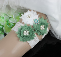 Wholesale Green Bridal Garter - Pearls Crystals Bridal Garters for Bride Lace Wedding Garters Free Shipping Purple Green Flowers Cheap Wedding Leg Garters