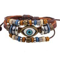 Wholesale Charm Brace - Europe and the United States national wind beads beads eye ornaments retro handmade leather bracelet men's bracelet wholesale 2017 hot brace