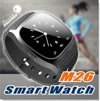 reloj alarma para niños al por mayor-Para apple iphone M26 smartwatch Bluetooth Smart Watch Teléfono con cámara Control remoto Alarma anti-perdida Barómetro relojes inteligentes