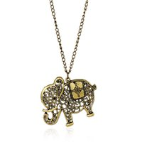 Wholesale Long Gold Elephant Fashion Necklace - Europe and the United States retro jewelry wholesale fashion carving hollow elephant long necklace pendant sweater chain