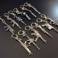 Wholesale Ceramic Crosses - Hot sale Through the fire line CF weapons gun mold alloy key ring 6cm pendant hot KR078 Keychains mix order 20 pieces a lot