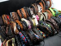leather cuff wristband bracelet großhandel-Großhandels100pcs verlosen Spitzensurfer-Stammes- lederne Stulpe-Armband-Armband-Schmucksachen für Mann-Frauen-Geschenk Mischart senden gelegentliches