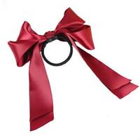 lazo de pelo de cinta roja al por mayor-Cuerda de la cinta Bowknot Lazos para el cabello Arco Banda elástica Accesorios para el cabello de niña Rojo # R46