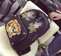 Wholesale Black Floral Canvas Backpack - outlet handbag new Europe and the United States fan tiger embroidery embroidery Oxford backpack travel steller backpack backpack individuali