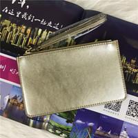 concepteurs de portefeuille femmes achat en gros de-32 couleurs marque portefeuilles designer poignet femmes monnaie sacs à main d'embrayage sacs à glissière pu design bracelets 27 couleurs
