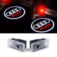 audi logosu led ışıkları toptan satış-Araba kapı lambaları logo projektör karşılama led lamba hayalet gölge ışıkları Için Audi A3 A4 Q5 Q7 TT A5 A8 A1 A8L A6L Q3 R8