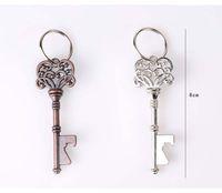 neuheit metall flaschenöffner großhandel-Haushalts Neuheit Mini Metall Schlüssel Bier Flaschenöffner Coca Dosenöffnungswerkzeug Unisex Dekorative Schlüsselbund Geschenk
